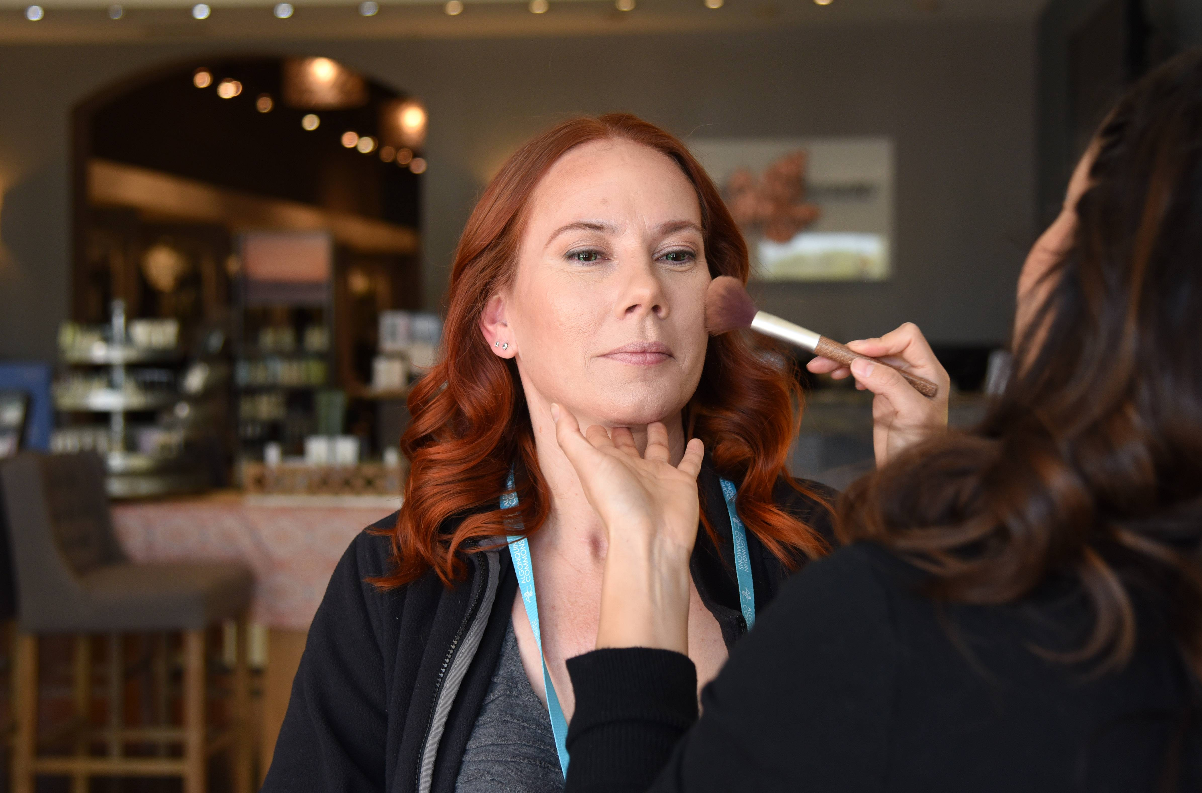 Kelly Galvan of Crystal Lake gets her makeup done by Jeanette Garcia at Taylor Stevens Salon in Algonquin Commons. Galvan was one of four winners of the Algonquin Commons March Makeover Madness contest. Winners had their hair and makeup done and also received $500 in mall gift cards.
