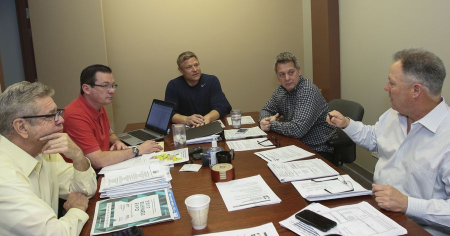 Mark Hoffmann, vice president of Ala Carte Entertainment in Schaumburg, holds a staff meeting. From left to right are Jim Earley, corporate general manager; William McFall III, director of operations; Mark Hoffmann; Michael Abbate, vice president of operations; and James Rosato, director of operations/suburban locations.