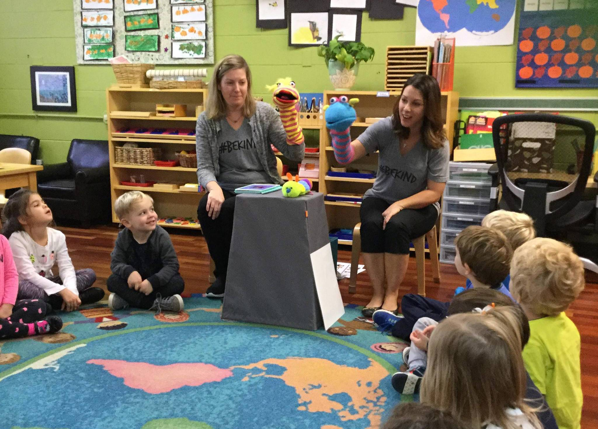 Cindy Feinendegen and Jen Christie, educators from the anti-bullying organization Fox and Trove, work with children at the Village Green Montessori in Libertyville. The organization will hold a kids march Saturday in downtown Libertyville.
