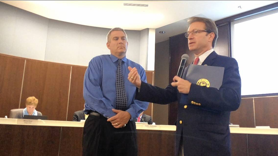 Republican U.S. Rep. Peter Roskam, right, publicly congratulated Palatine for being among the suburbs considered the safest places in the United States. Palatine Mayor Jim Schwantz stepped from the village council dais to join Roskam at Monday night's meeting.