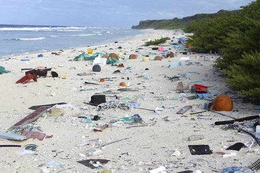 In this 2015 photo provided by Jennifer Lavers, plastic debris is strewn on the beach on Henderson Island. When researchers traveled to the tiny, uninhabited island in the middle of the Pacific Ocean, they were astonished to find an estimated 38 million pieces of trash washed up on the beaches. (Jennifer Lavers via AP)