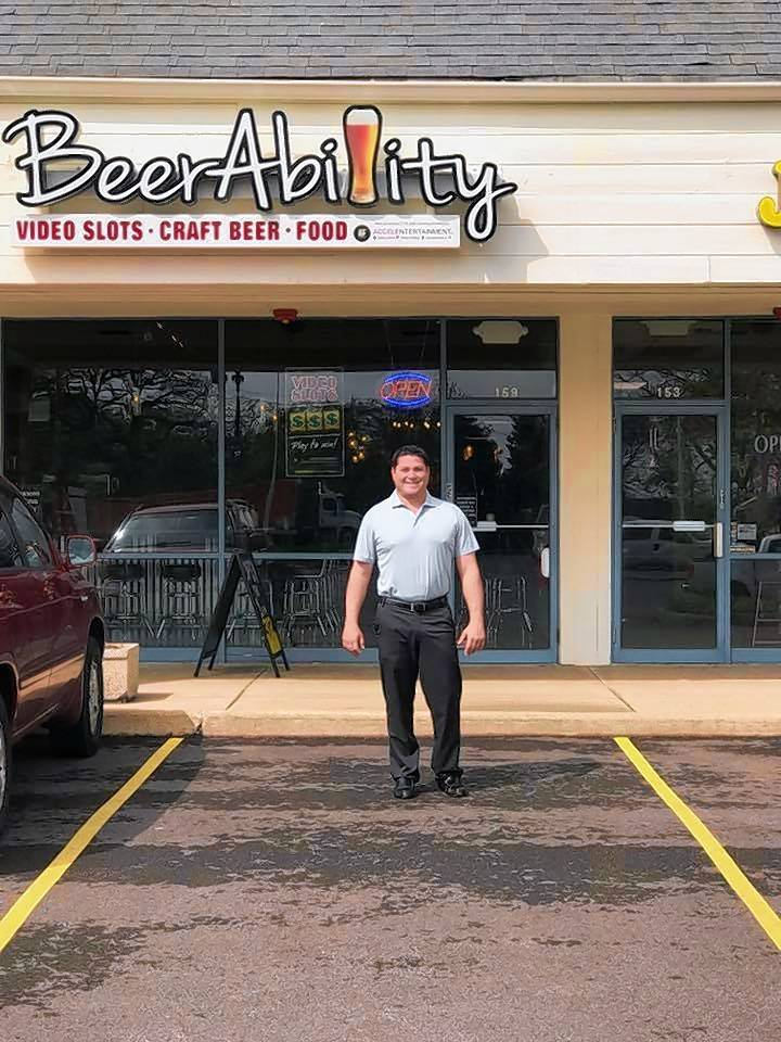 President Jason Newman stands in front of BeerAbility, a new chain of sports bars that offer about 20 beers on tap, various drink and food items, as well as video gambling and slots.