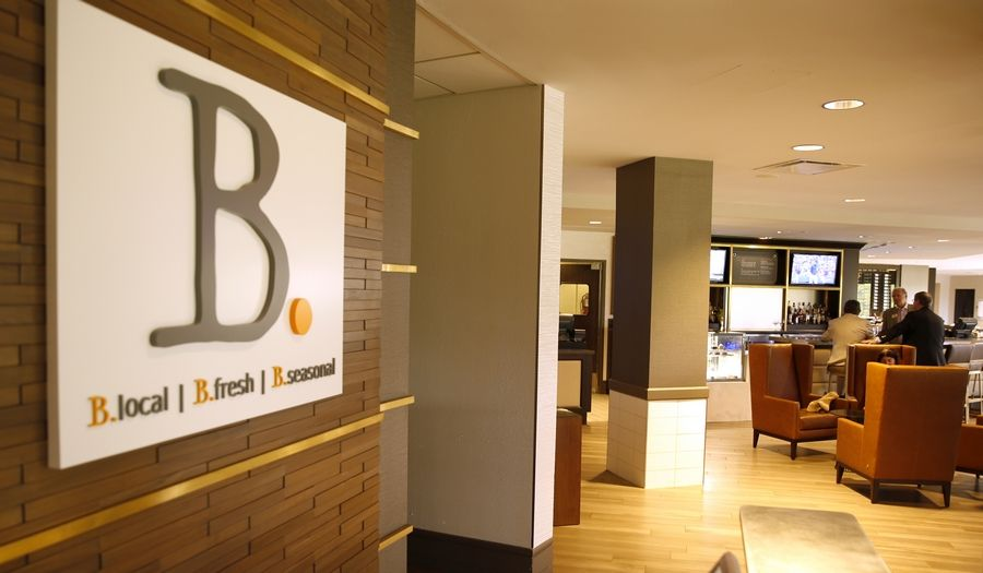 B. Restaurant starts in the lounge area near the lobby, melds into a bar and then the dining room in the Hilton Chicago/Oak Brook Hills Resort.
