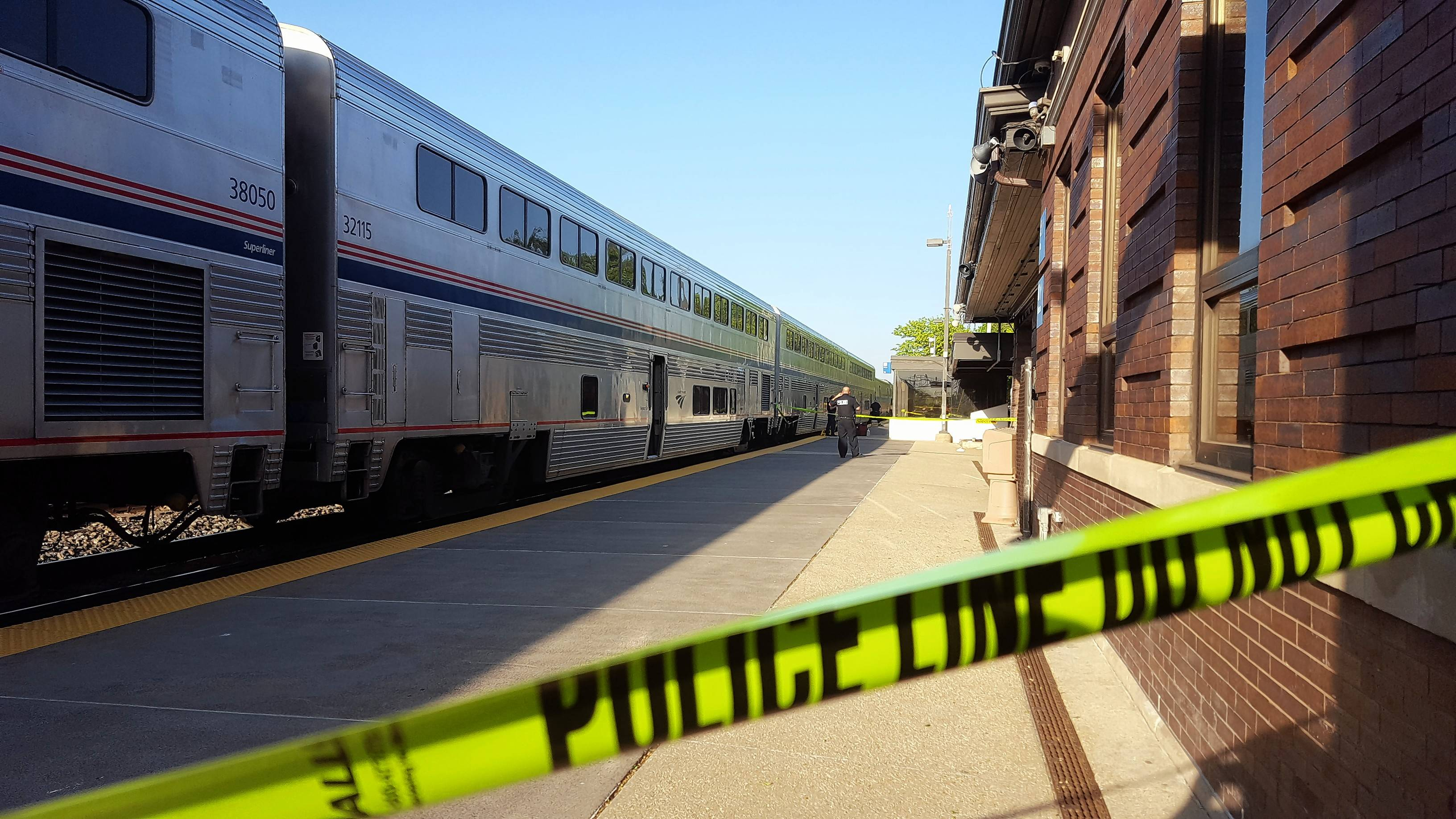 Authorities said activity was back to normal the day after a conductor was shot at the 5th Avenue station in Naperville.