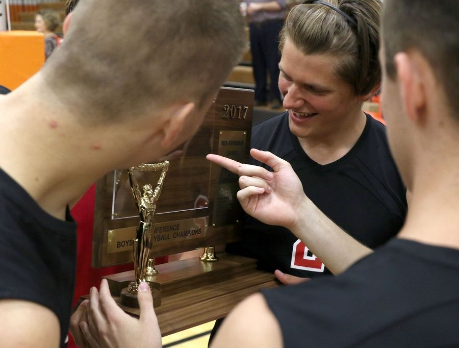 Barrington players, including Michael Hagan, center, admire their hardware after a victory over Hersey in the Mid-Suburban League title game.