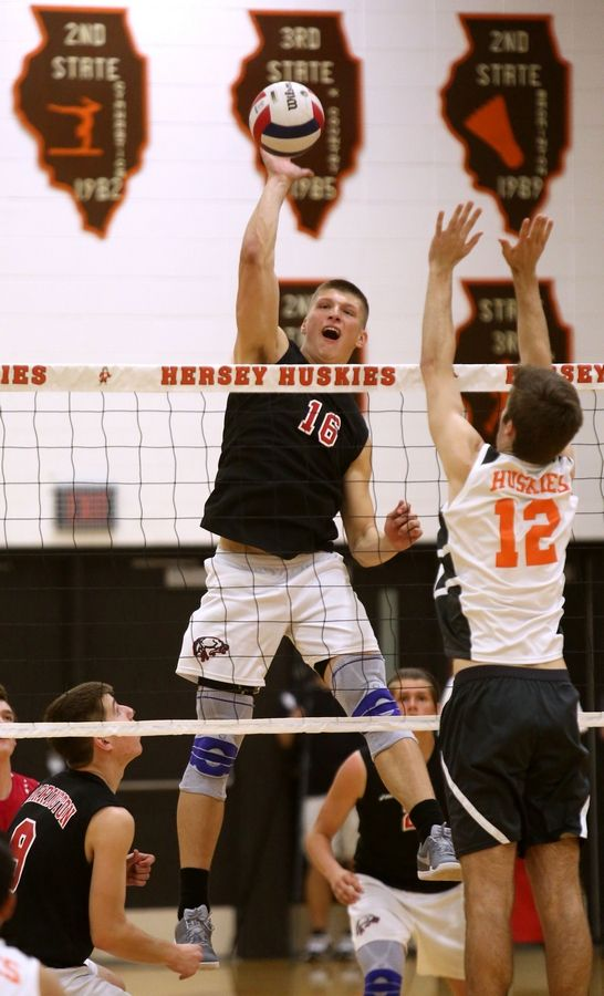Hersey's Joe Nugent, right, prepares to block Barrington's Josh Babicz during the Mid-Suburban League title game at Carter Gymnasium on Wednesday night.