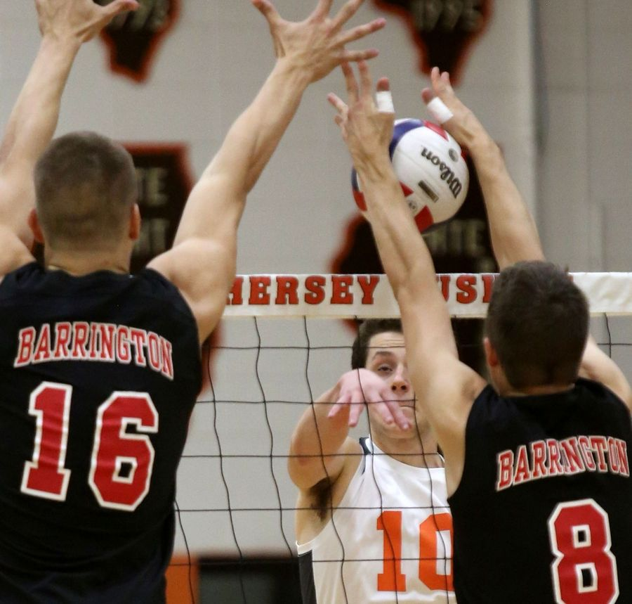 Hersey's Jake Mailloux, center, tries to strike the ball past Barrington's Josh Babicz, left, and Jacob Werner, right, during Mid-Suburban League title game.