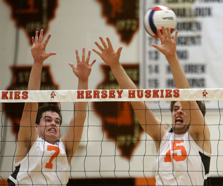 Hersey's Vince Reisel, left, and Matt Hopkins, right, block against Barrington during the Mid-Suburban League title game.
