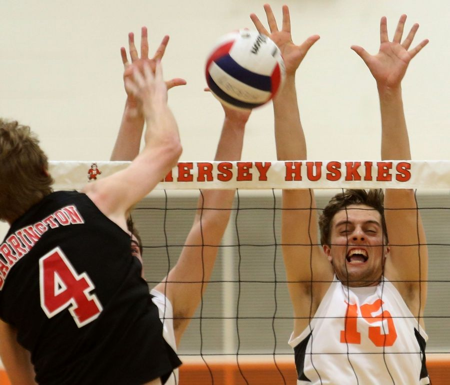 Hersey's Matt Hopkins, right, blocks against Barrington's Sean Dolan during the Mid-Suburban League title game Wednesday at Carter Gymnasium.