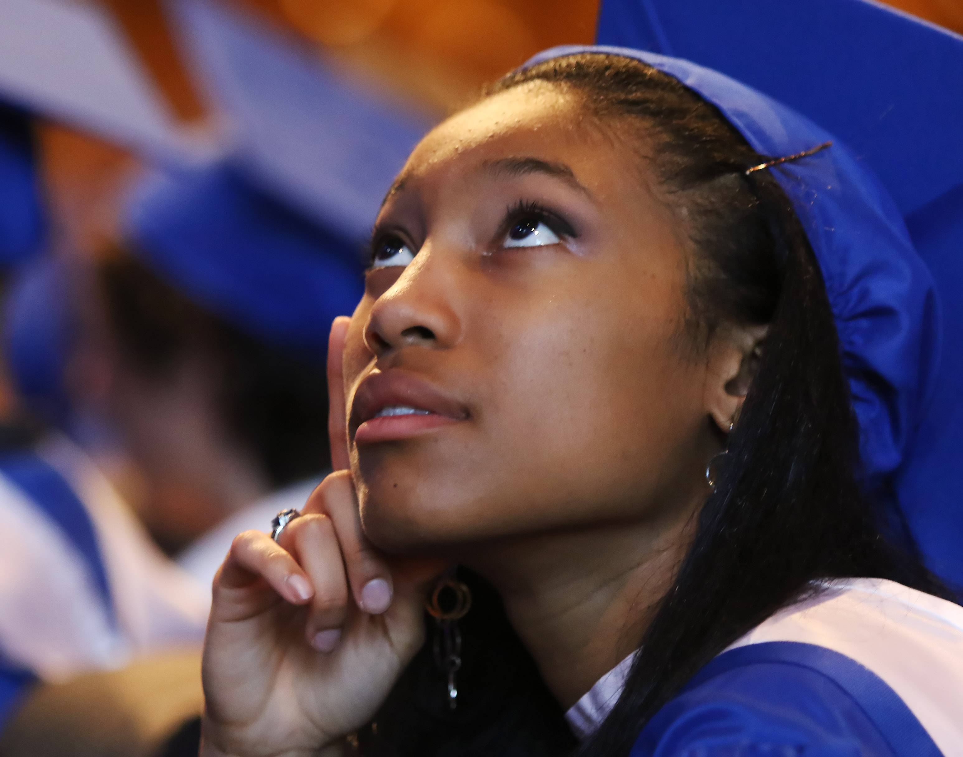 Chloe Jefferson looks up at the speakers during the Hoffman Estates High School graduation Thursday at Willow Creek Church in South Barrington. The graduating class of 470 participated in the commencement exercises.