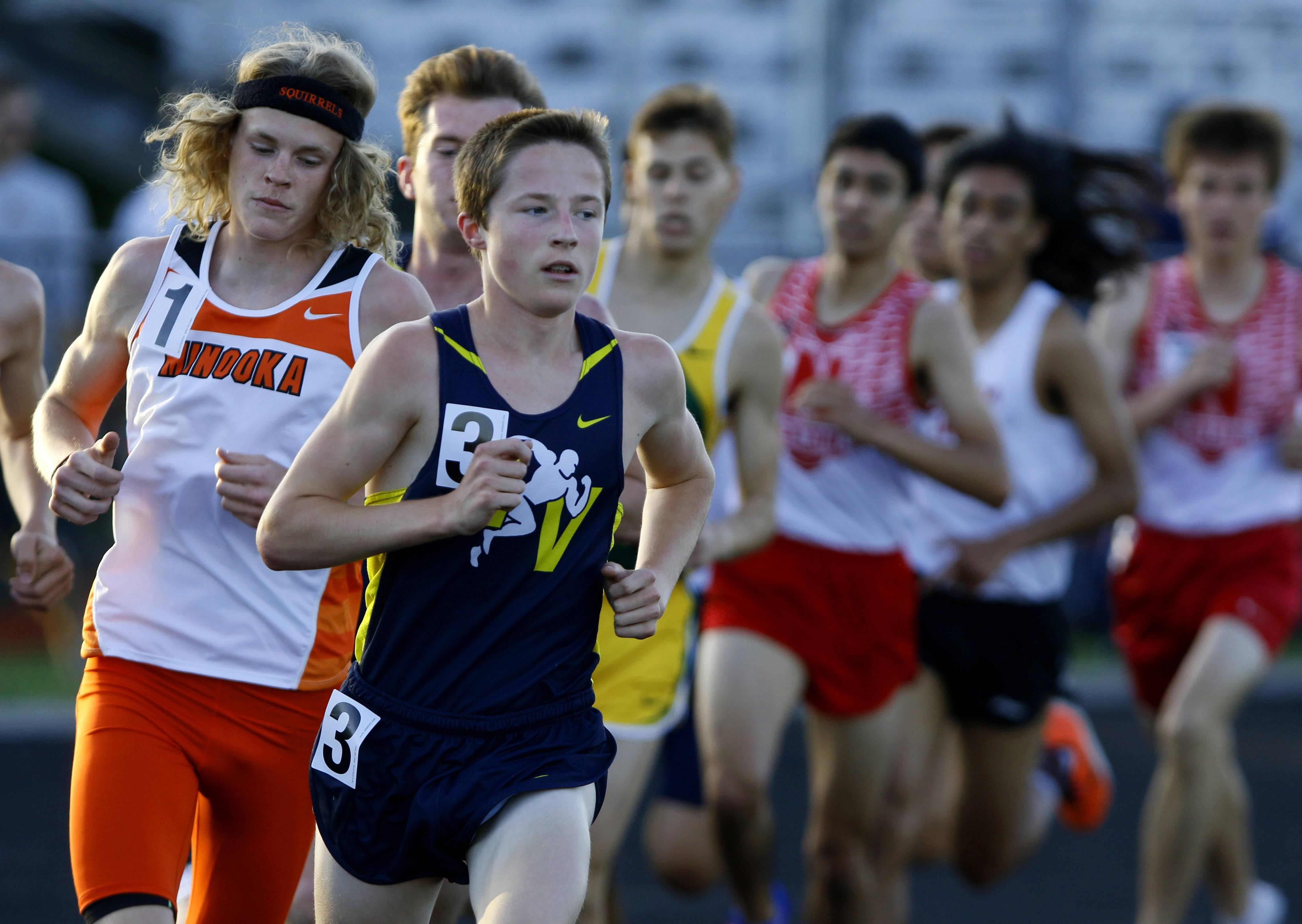 Neuqua Valley's Zachary Kinne gets out to an early lead in the 3200 meter run during the Naperville North boys track sectional.