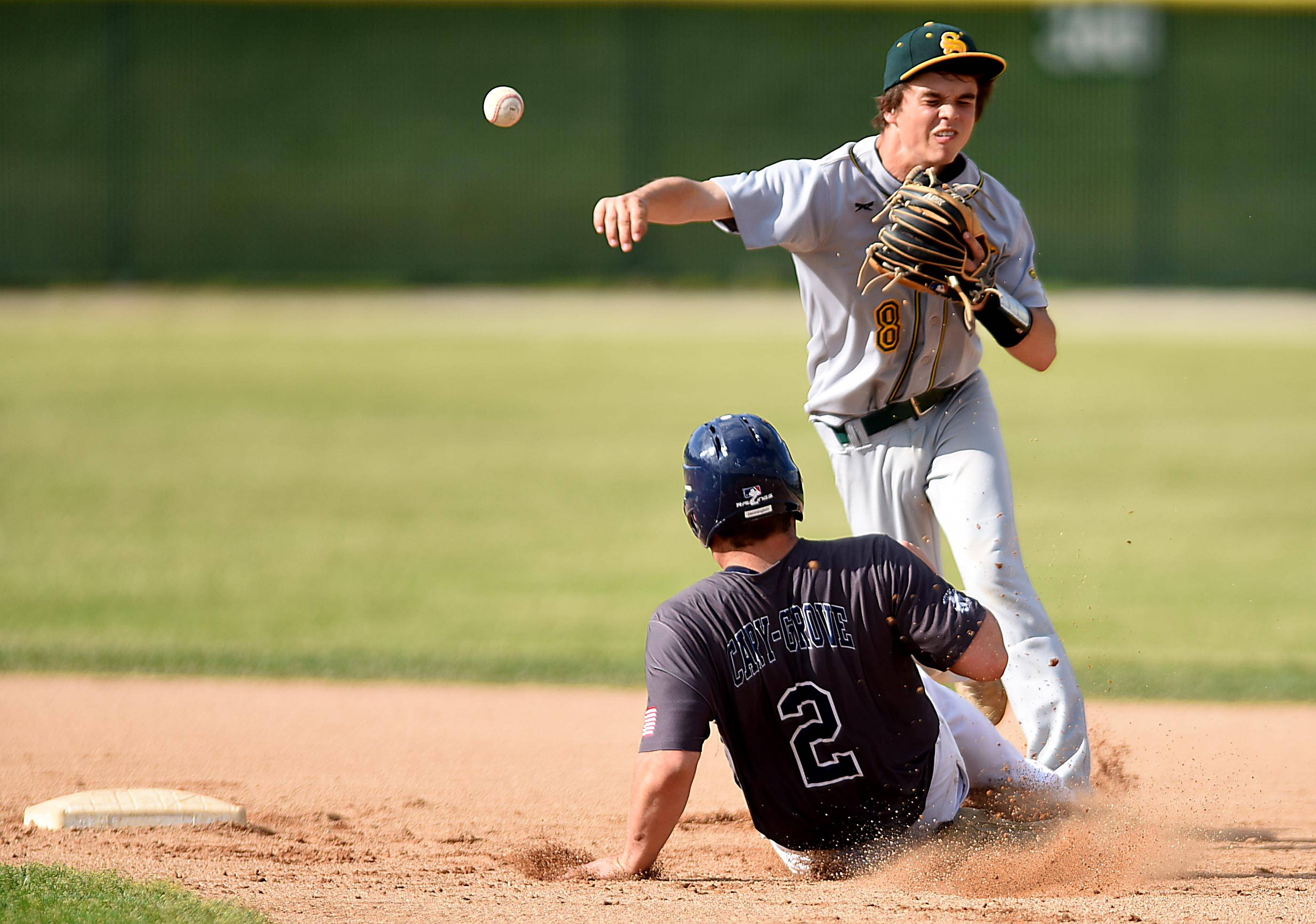 Crystal Lake South's Kory Olsen forces out Cary-Grove's Tyler Pennington and turns a double play on Justin Trausch Thursday in Cary.