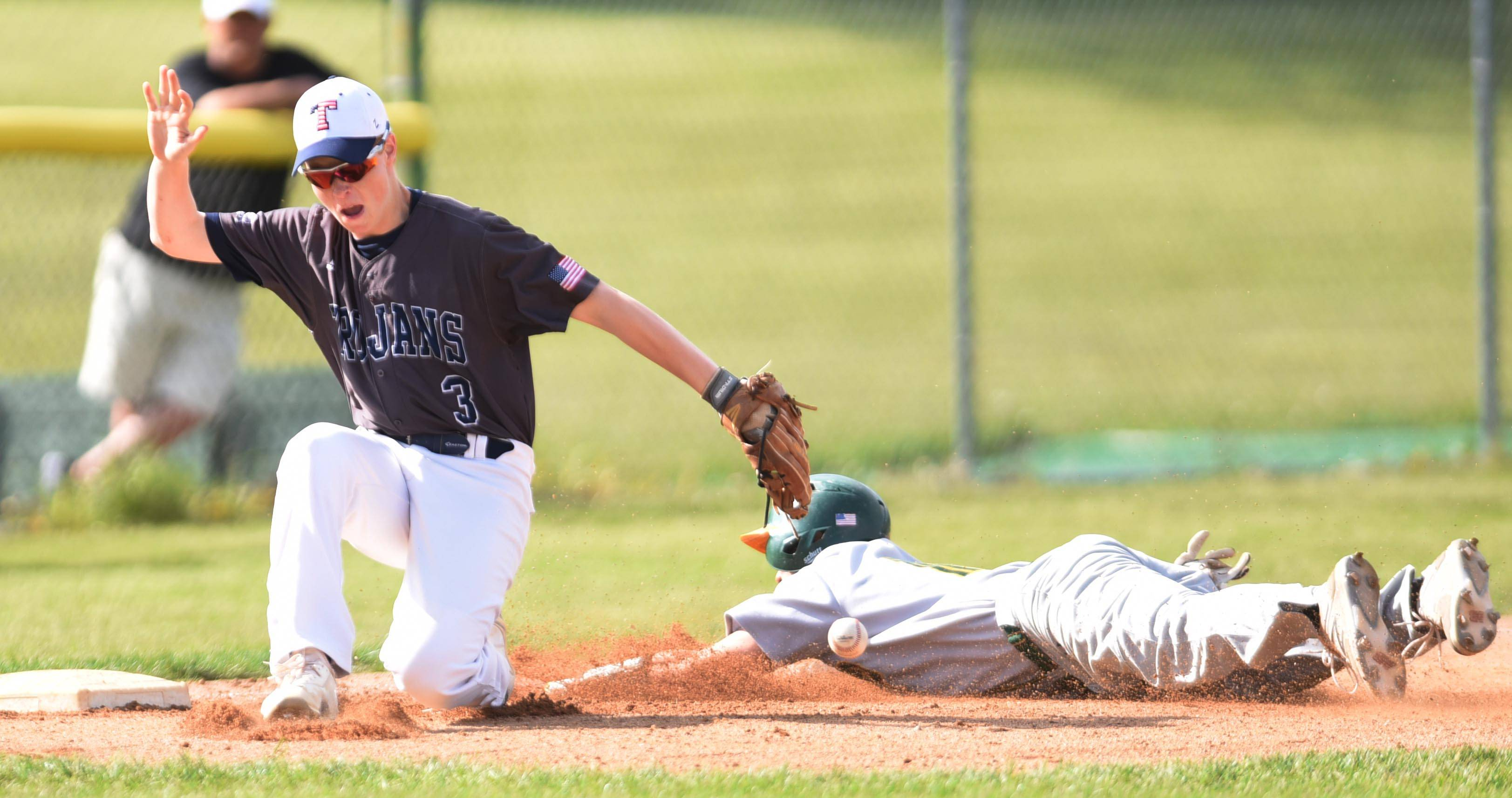 Crystal Lake South's Brent Chubb slides safely into third as Cary-Grove's Luc Bressett loses control of the ball in the first inning Thursday in Cary.