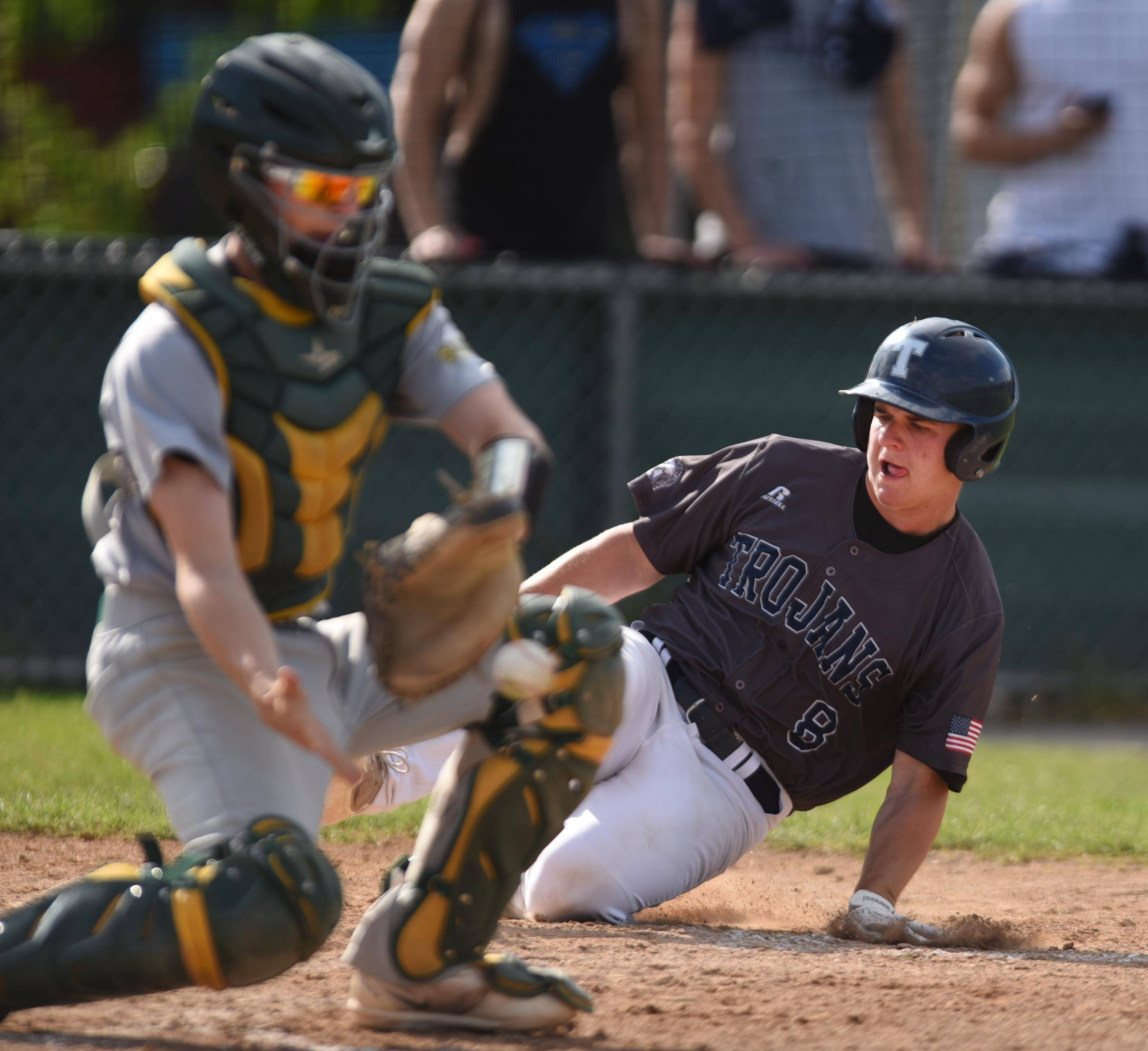 Cary-Grove's Collin Walsh scores on a hit by teammate Tyler Pennington as Crystal Lake South catcher Ryan Parquette fields the throw in the first inning Thursday in Cary.