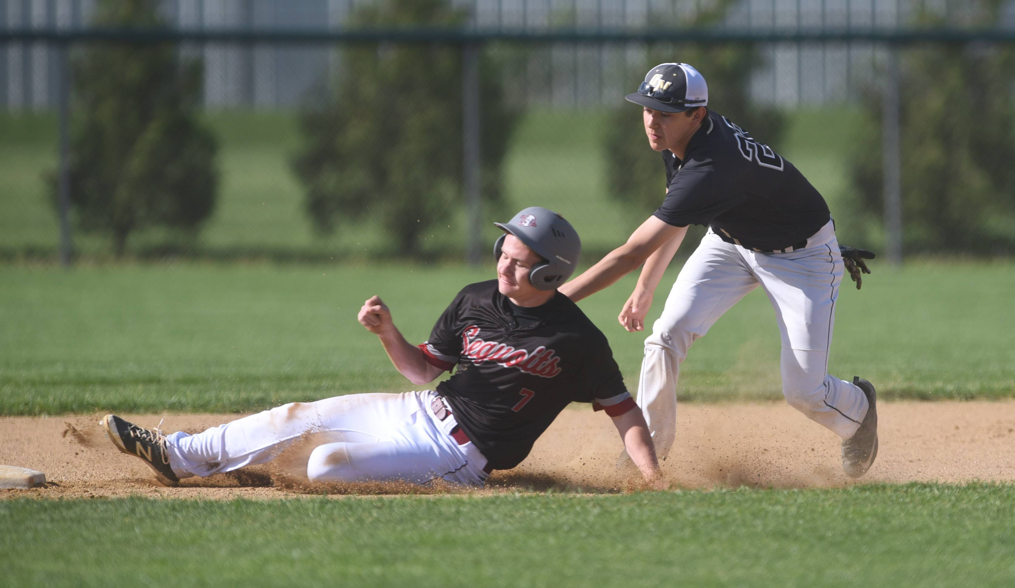 Antioch's Connor Geidner (7) slides into second base but is tagged out by Grayslake North's Sebastian Sancen during Thursday's game in Antioch.