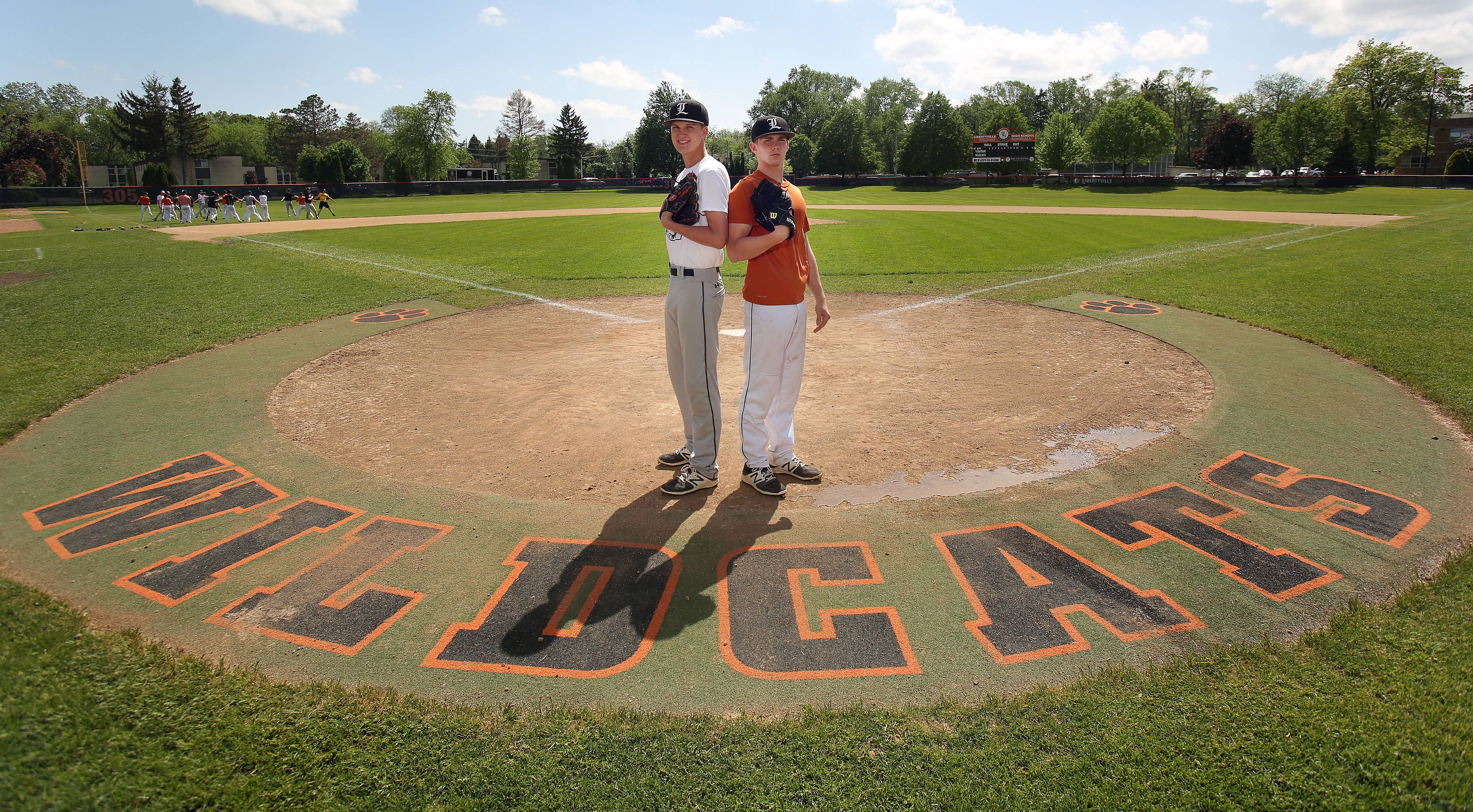 Libertyville senior pitchers Ben Land, left, and Caleb Haddon have helped Libertyville win the NSC title and are going to pitch at the same college next year, DePauw University.