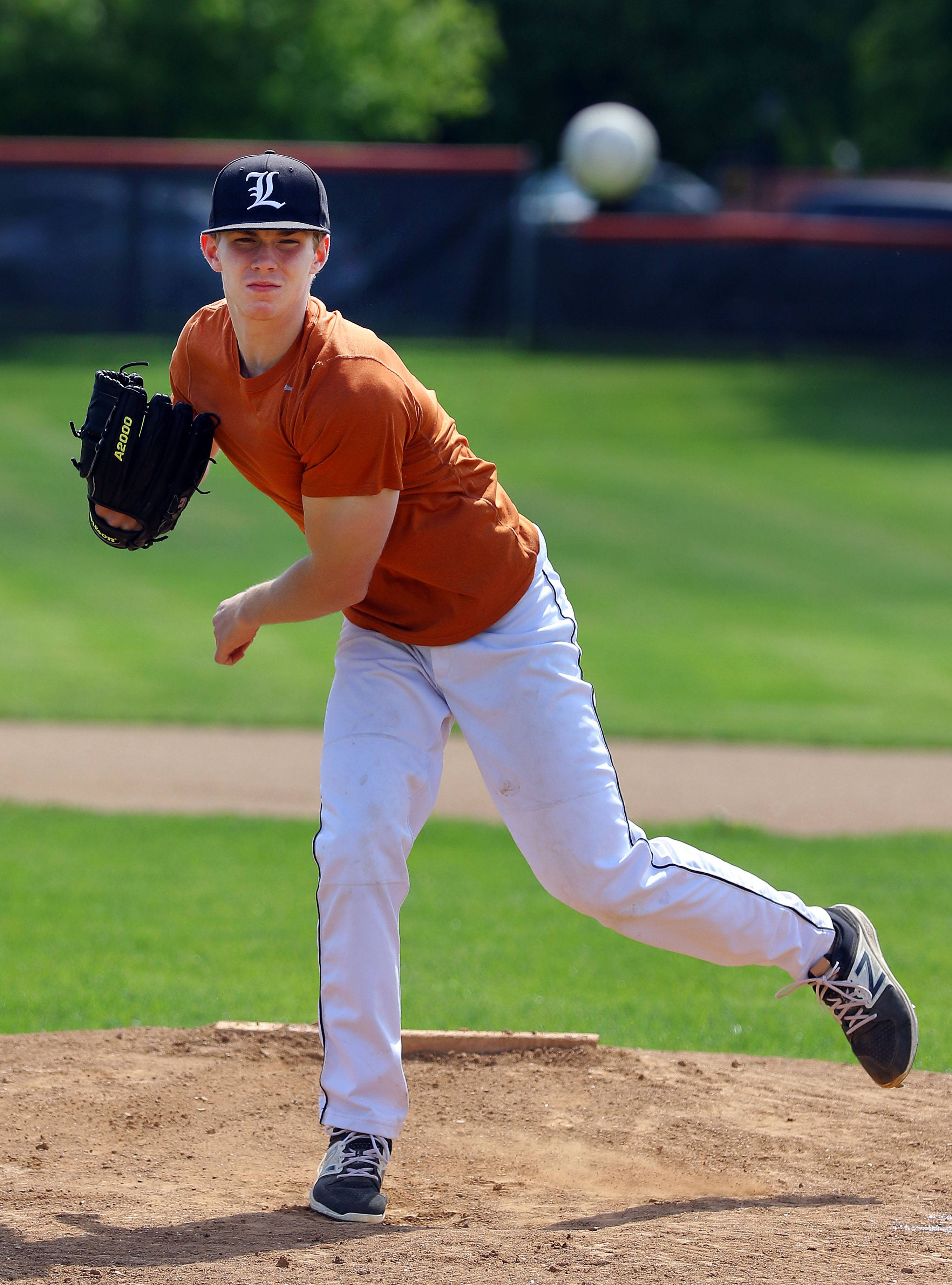 Libertyville senior Caleb Haddon pitches during practice.