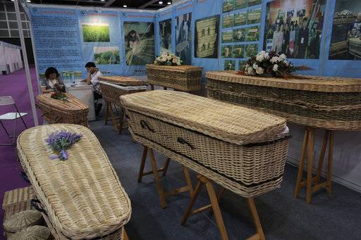 Wicker and seagrass coffins are displayed at the Asia Funeral and Cemetery Expo & Conference in Hong Kong, Thursday, May 18, 2017. The expo underscores how for some investors Asia's rapidly aging population makes its death industry a potentially lucrative market. Asia's aging population is projected to hit 923 million by mid-century, according to an Asian Development Bank, putting the region on track to become the oldest in the world. (AP Photo/Vincent Yu)