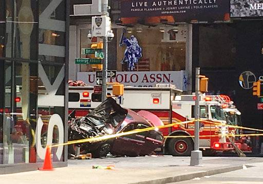 A smashed car sits on the corner of Broadway and 45th Street in New York's Times Square after driving through a crowd of pedestrians Thursday, May 18, 2017. (AP Photo/Seth Wenig)