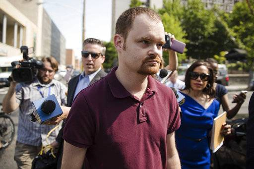 Brandon Bostian, the Amtrak engineer involved in a fatal train crash two years ago, walks to a police station in Philadelphia on Thursday, May 18, 2017, to turn himself in to answer charges including causing a catastrophe and involuntary manslaughter. (AP Photo/Matt Rourke)