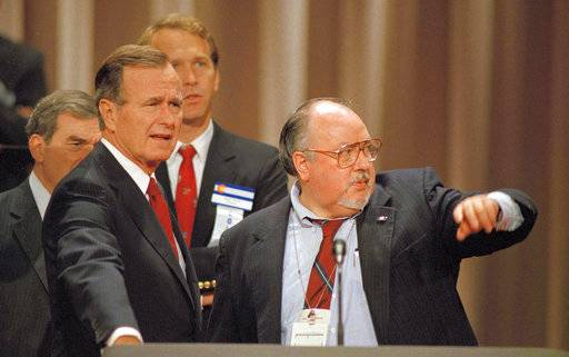 FILE - In this Aug. 17, 1988 file photo, Vice President George H.W. Bush, left, gets some advice from his media advisor, Roger Ailes, right, as they stand behind the podium at the Superdome in New Orleans, La., prior to the start of the Republican National Convention.  Fox News said on Thursday, May 18, 2017, that Ailes has died. He was 77.