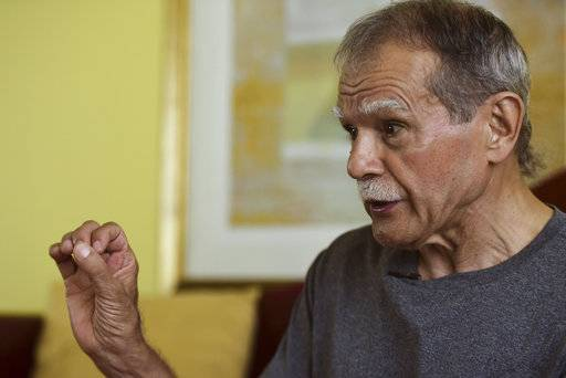 Puerto Rican nationalist Oscar Lopez Rivera gives an interview following his release from house arrest after decades in custody, in San Juan, Puerto Rico, Wednesday, May 17, 2017. Lopez was considered a top leader of the Armed Forces of National Liberation, or FALN, an ultranationalist Puerto Rican group that claimed responsibility for more than 100 bombings at government buildings, department stores, banks and restaurants in New York, Chicago, Washington and Puerto Rico during the 1970s and early 1980s. (AP Photo/Carlos Giusti) PUERTO RICO OUT - NO PUBLICAR EN PUERTO RICO