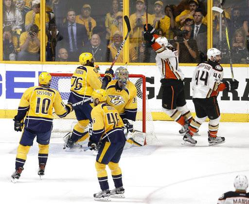 Anaheim Ducks center Nate Thompson (44) and center Ryan Getzlaf, second from right, celebrate after beating the Nashville Predators in overtime in Game 4 of the Western Conference final in the NHL hockey Stanley Cup playoffs Thursday, May 18, 2017, in Nashville, Tenn. The Ducks won 3-2 to even the series 2-2. (AP Photo/Mark Humphrey)
