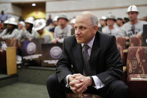 Oakland Raiders President Marc Badain listens during a meeting of the Las Vegas Stadium Authority board, Thursday, May 18, 2017, in Las Vegas. The public entity that oversees the proposed stadium where the Raiders want to start playing in 2020 has approved a conditional lease agreement for the facility. (AP Photo/John Locher)
