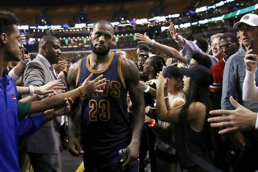 Cleveland Cavaliers forward LeBron James leaves the court after Game 1 of the team's NBA basketball Eastern Conference finals against the Boston Celtics, Wednesday, May 17, 2017, in Boston. The Cavaliers won 117-104. (AP Photo/Charles Krupa)