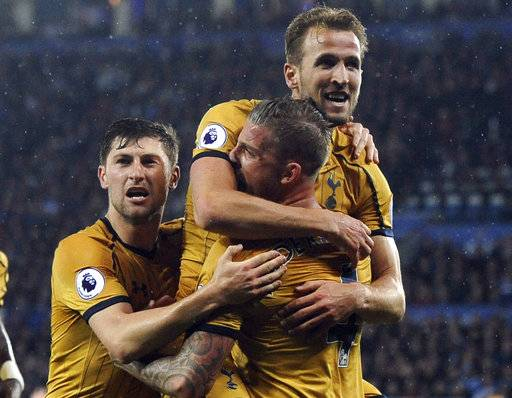 Tottenham's Harry Kane, top, celebrates scoring his second goal during the English Premier League soccer match between Leicester City and Tottenham Hotspur at the King Power Stadium in Leicester, England, Thursday, May 18, 2017. (AP Photo/Rui Vieira)