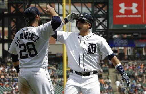 Detroit Tigers designated hitter Victor Martinez, right, is congratulated by J.D. Martinez after reaching home plate on a two-run home run during the fifth inning of a baseball game against the Baltimore Orioles, Thursday, May 18, 2017, in Detroit. (AP Photo/Carlos Osorio)