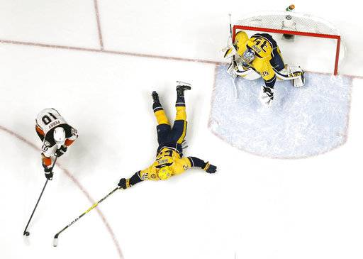 Nashville Predators defenseman Matt Irwin (52) reaches to block a shot by Anaheim Ducks right wing Corey Perry (10) as goalie Pekka Rinne (35), of Finland, guards the net during the third period in Game 3 of the Western Conference final in the NHL hockey Stanley Cup playoffs Tuesday, May 16, 2017, in Nashville, Tenn. The Predators won 2-1 and lead the series 2-1. (AP Photo/Mark Humphrey)