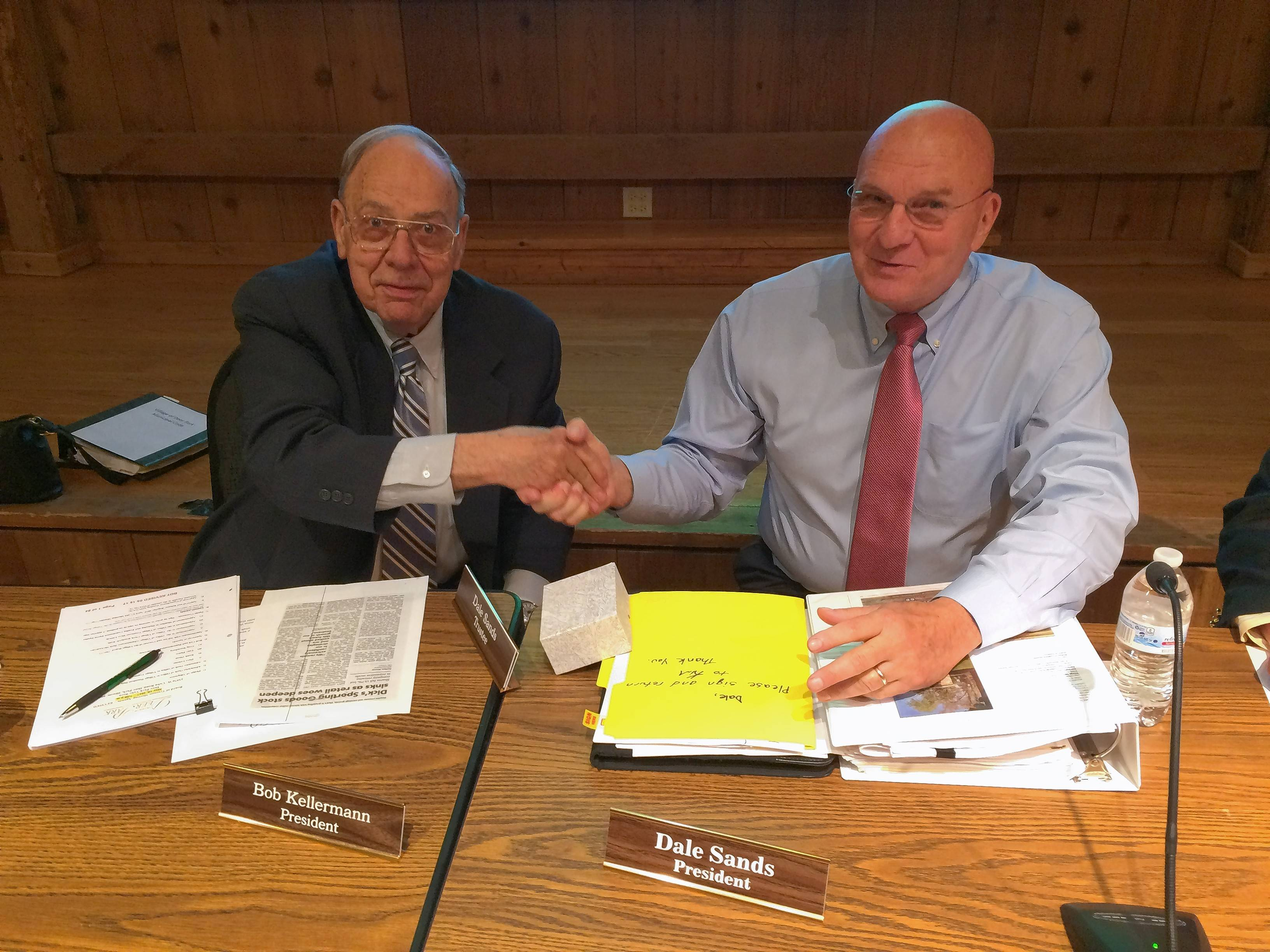 Bob Kellermann, left, ended his eight-year term as Deer Park village president Thursday night. Dale Sands was sworn in as the village's top elected official.