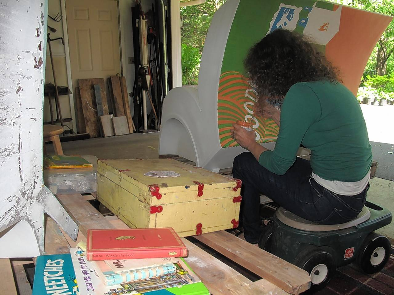 "The garage studio at Marianne Lisson Kuhn's house in Naperville contains books like ""The Sneetches"" by Dr. Seuss and a vintage Winnie the Pooh, which she is using as inspiration for three book bench sculptures she is painting for display this summer in the city's downtown."