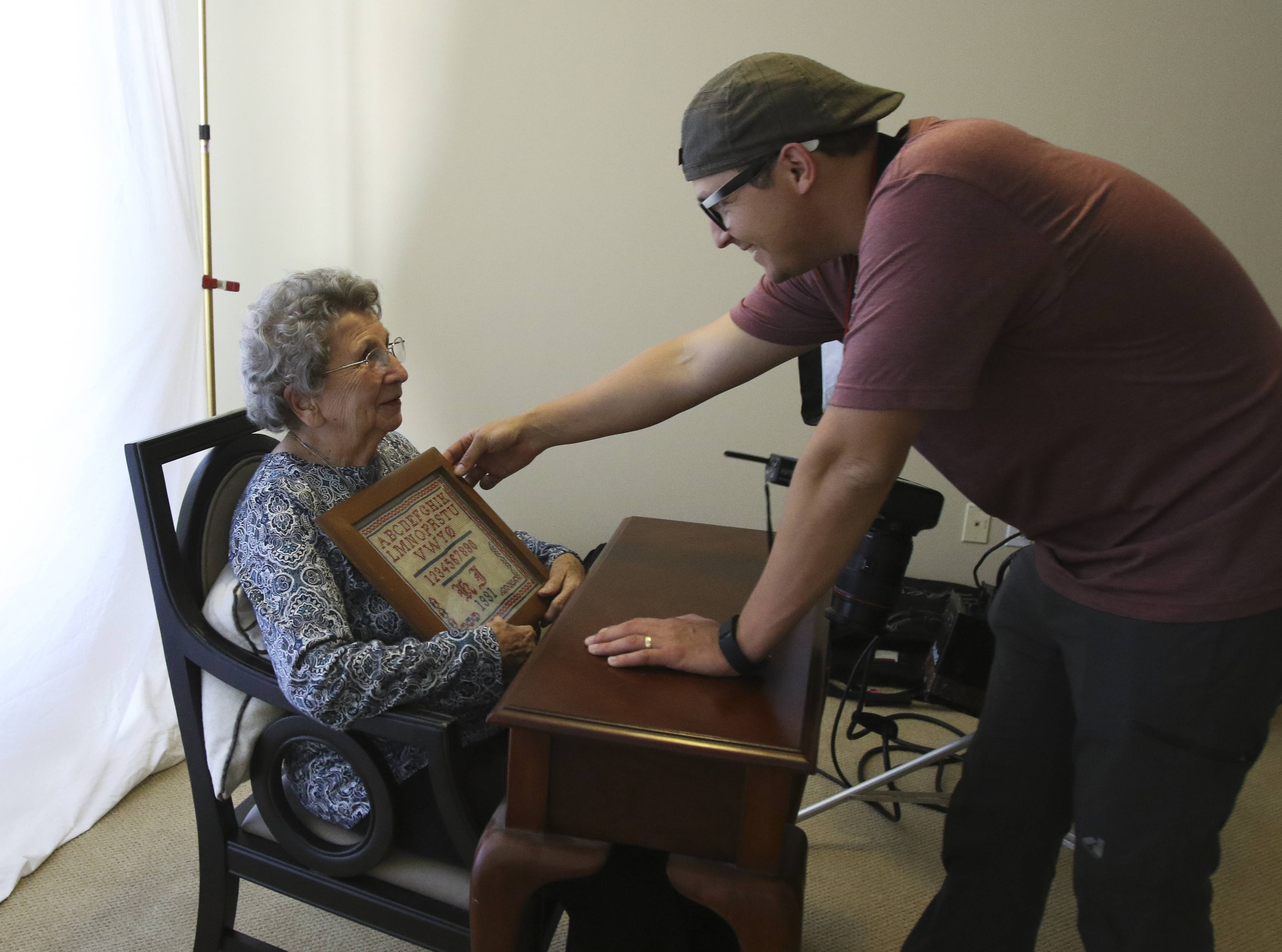 "Photographer Tom Sanders gets Karin Jaeger, 100, set for her portrait. ""It's nice to give them the time and tell their story,"" the California shutterbug said. ""They're full of wisdom."""