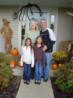 Patty and Russell Coffland with Brittany, left, and Tiffany outside Randy and Anjum's house in St. Charles, celebrating Halloween.