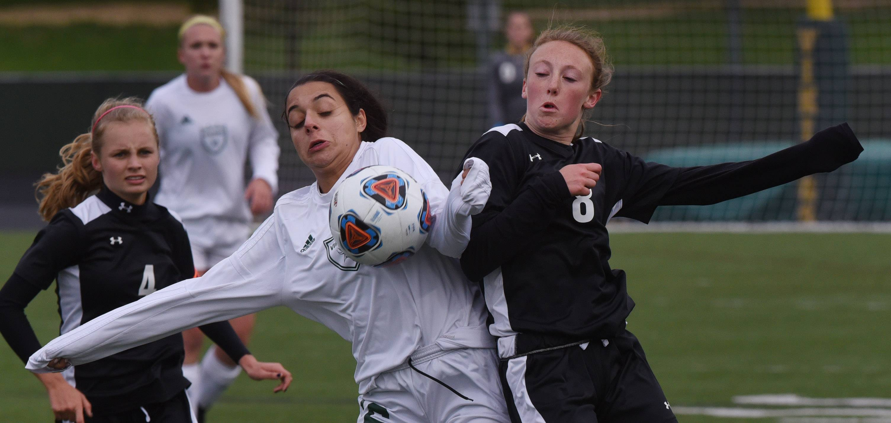 Fremd's Layla Dib, left, and Libertyville's Emma Hollinger make contact as they pursue the ball during the Class 3A girls soccer regional final match in Palatine on Friday.