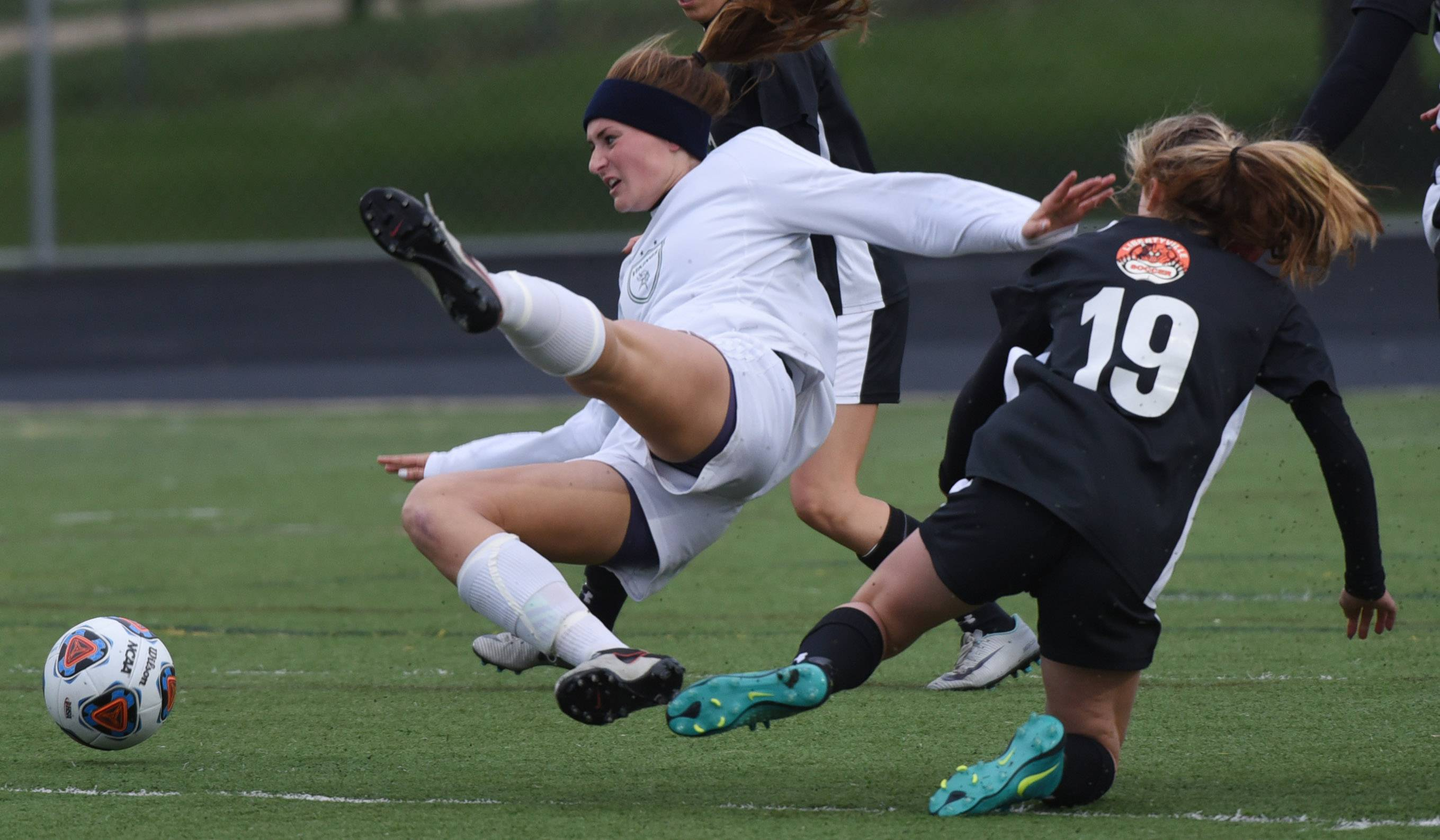 Fremd's Missy Adrian, left, and Libertyville's Morgan Verbeten hit turf during the Class 3A girls soccer regional final play in Palatine on Friday.