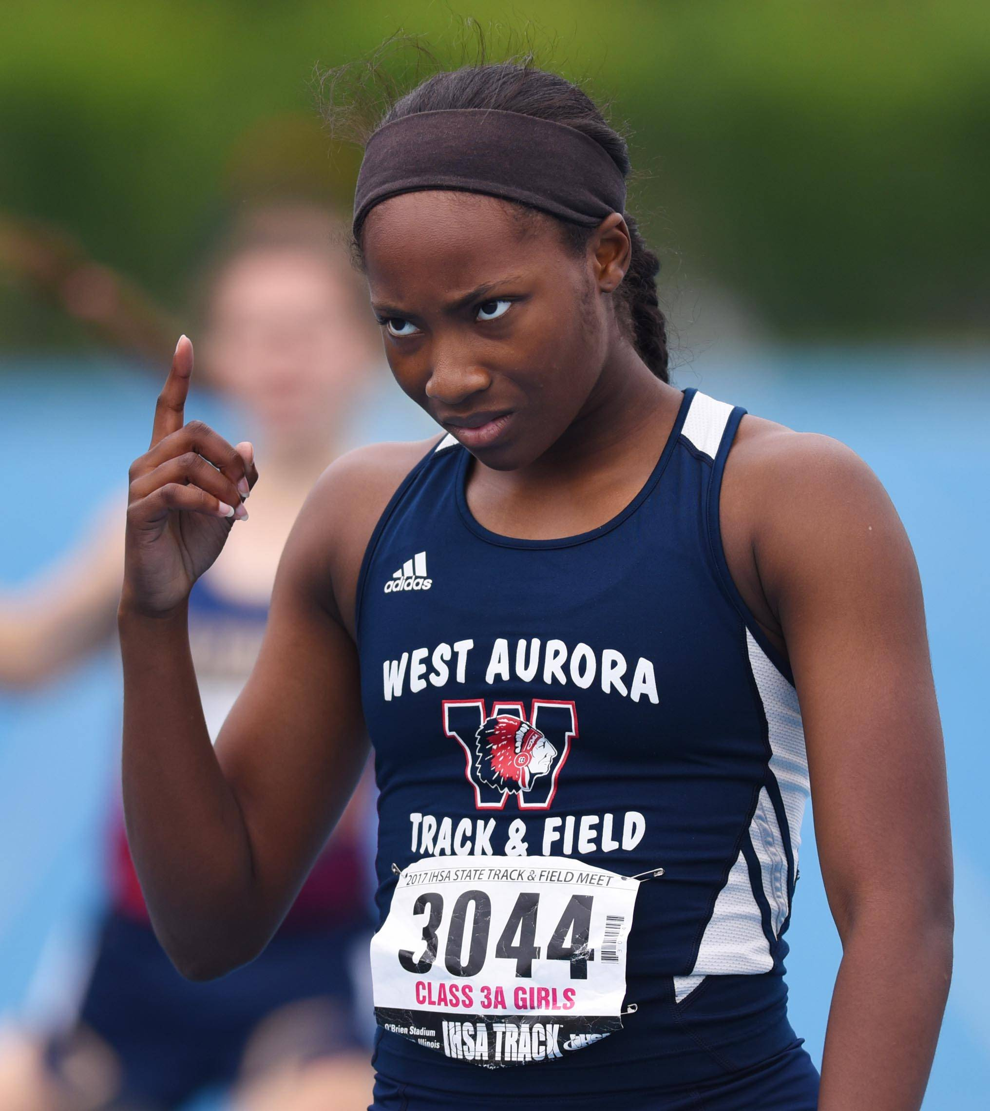 West Aurora's Dajour Miles reacts to her win in the Class 3A 400-Meter Dash at the prelims of the state girls track and field meet Friday at Eastern Illinois University in Charleston.
