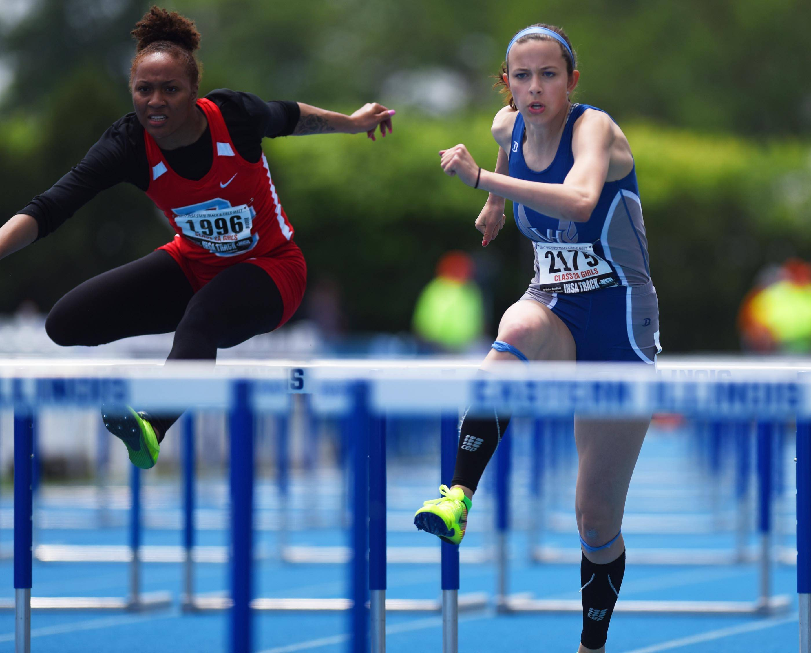 Vernon Hills' Jordyn Bunning, right, competes in the Class 2A 100-meter high hurdles during the girls track and field state meet prelims Friday at Eastern Illinois University in Charleston.