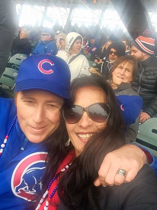 "Michael Case, with wife Sara, is a big Cubs fan. The Amtrak conductor was shot Tuesday on the train platform in Naperville. ""You never think your husband is going to go to work and be shot,"" his wife said."