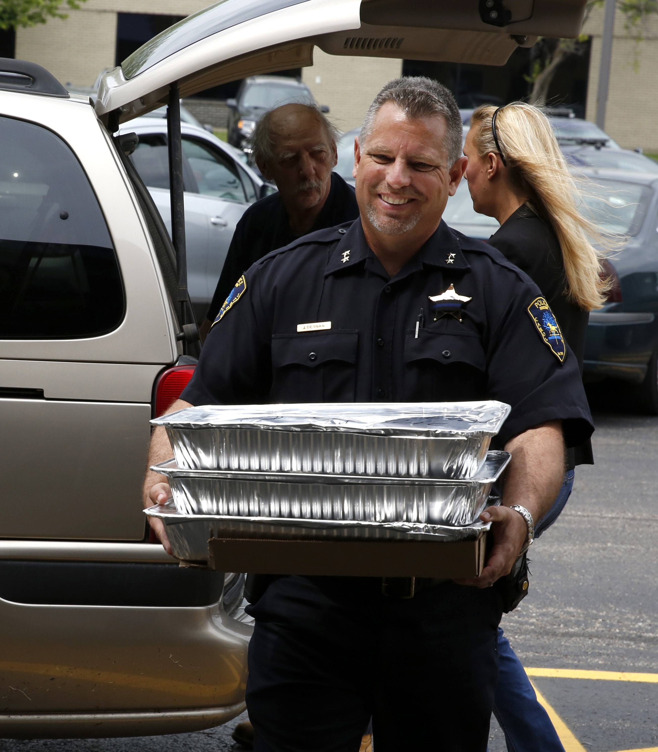 Carol Stream Deputy Police Chief Jeff Degnan carried food from Rosati's, which delivered lunch for officers in honor of National Police Week.