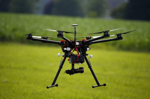 FILE - In this June 11, 2015, file photo, a hexacopter drone is flown during a drone demonstration in Cordova, Md. An appeals court has struck down a Federal Aviation Administration rule that required owners to register drones used for recreation. (AP Photo/Alex Brandon, File)