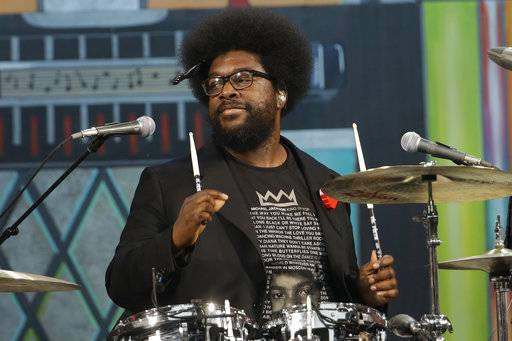 "FILE – In this July 4, 2012, file photo, Ahmir ""Questlove"" Thompson of The Roots performs during an Independence Day celebration in Philadelphia. The drummer and DJ assured students at a Pennsylvania high school Friday, May 19, 2017, that he will perform at their prom despite unexpectedly canceling days earlier, posting on Twitter he ""adjusted some things"" to perform during the Saturday, May 20, 2017, senior prom for Pennsbury High School's East Campus in Fairless Hills, Pa. (AP Photo/Matt Rourke, File)"