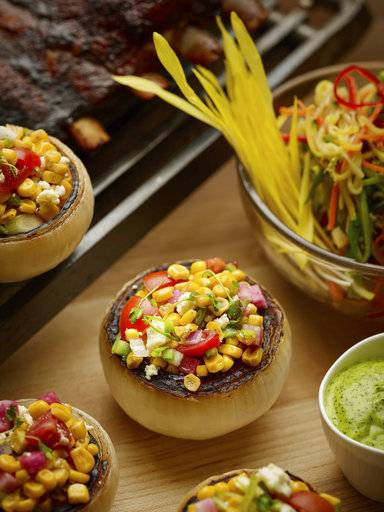 This April 2017 photo provided by The Culinary Institute of America shows Mexican-style corn salad in Hyde Park, N.Y. This dish is from a recipe by The Culinary Institute of America. (Phil Mansfield/The Culinary Institute of America via AP)