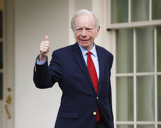 Former Connecticut Sen. Joe Lieberman gives a 'thumbs-up' as he leaves the West Wing of the White House in Washington, Wednesday, May 17, 2017. The White House says President Donald Trump will be interviewing four potential candidates to lead the FBI.