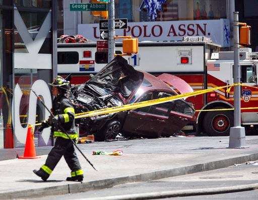 A smashed car sits on the corner of Broadway and 45th Street in New York's Times Square after ploughing through a crowd of pedestrians at lunchtime on Thursday, May 18, 2017. Police do not suspect a link to terrorism and the driver was taken into custody to be tested for alcohol.