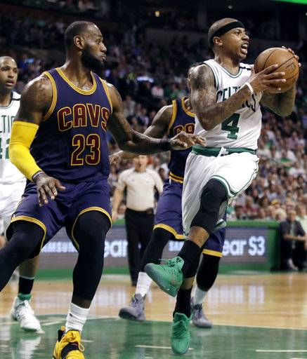 Boston Celtics guard Isaiah Thomas (4) tries to move the ball in front of Cleveland Cavaliers forward LeBron James (23) during first half of Game 2 of the NBA basketball Eastern Conference finals, Friday, May 19, 2017, in Boston. (AP Photo/Elise Amendola)
