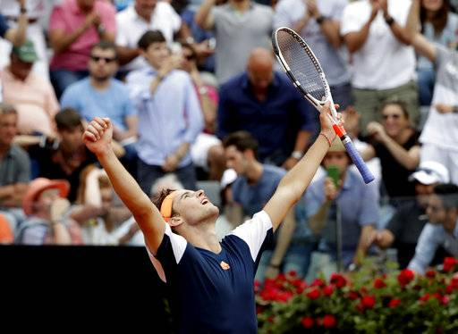 Dominic Thiem of Austria celebrates after beating Rafael Nadal of Spain at the Italian Open tennis tournament, in Rome, Friday, May 19, 2017. (AP Photo/Alessandra Tarantino)