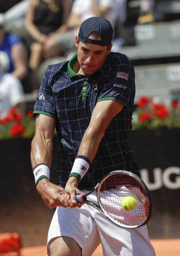 John Isner of the United States returns the ball to Croatia's Marin Cilic during their match at the Italian Open tennis tournament, in Rome, Friday, May 19, 2017.